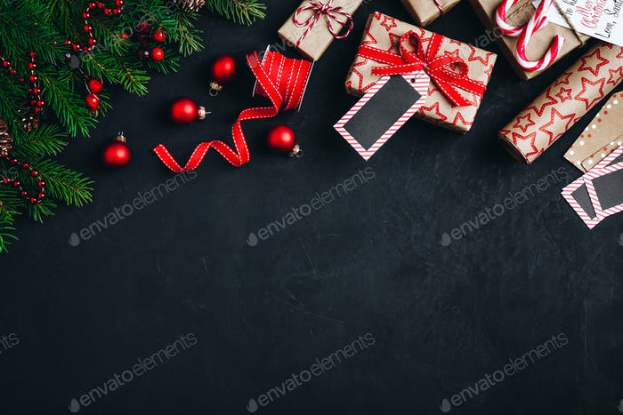 Christmas background with fir branches and cones, gift boxes