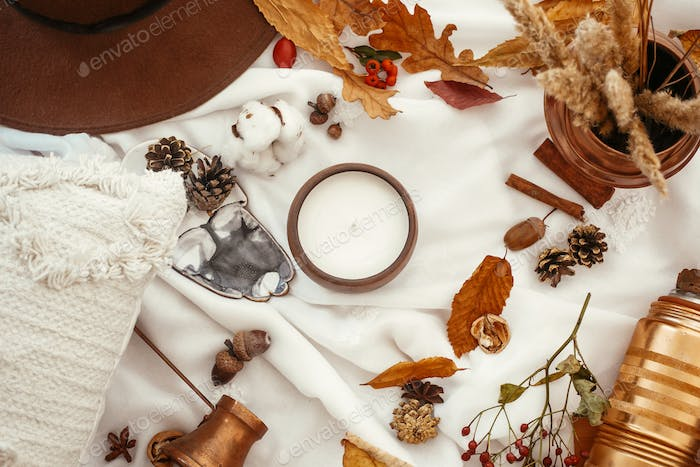 Stylish Autumn Flat Lay. Beautiful fall leaves, candle