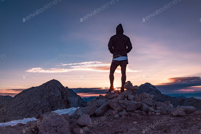 Male hiker in the grand mountain landscape