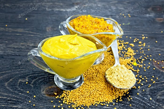 Sauce mustard in two sauceboats with powder on board