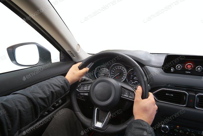 Man in car hold steering wheel.