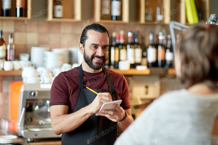man or waiter serving customer at bar