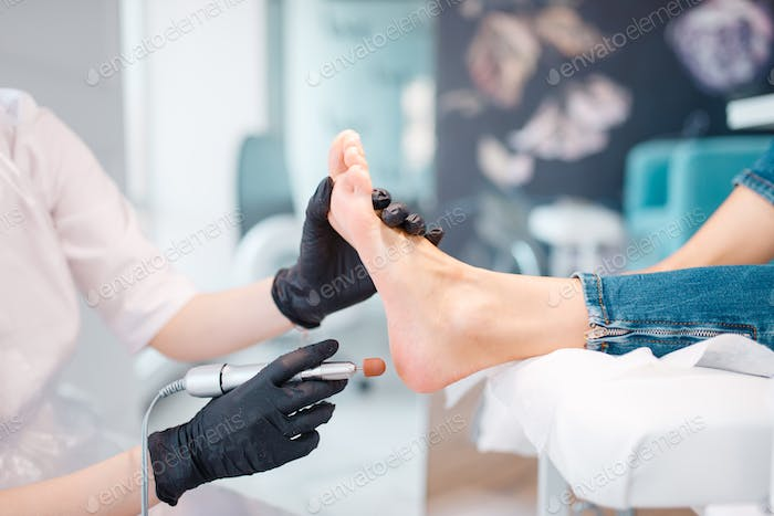 Beautician salon, foot polish procedure