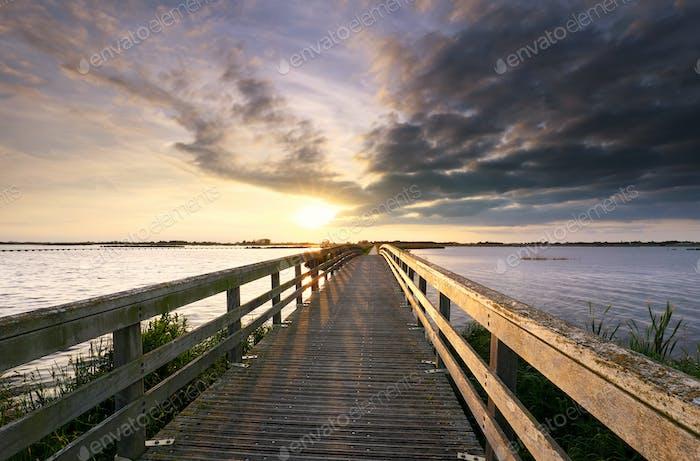 evening sunshine over wooden bridge