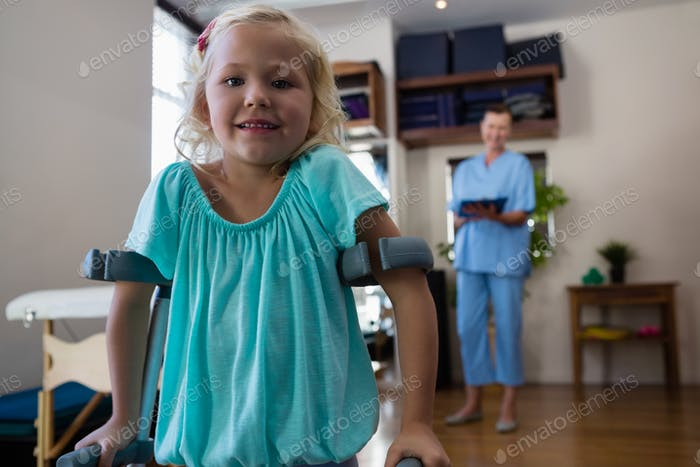 Portrait of smiling girl with crutches