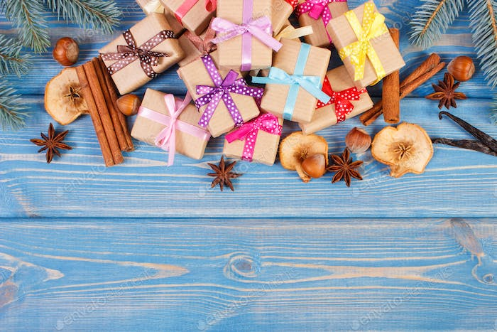 Wrapped gifts with ribbons for Christmas, spices and spruce branches, copy space for text