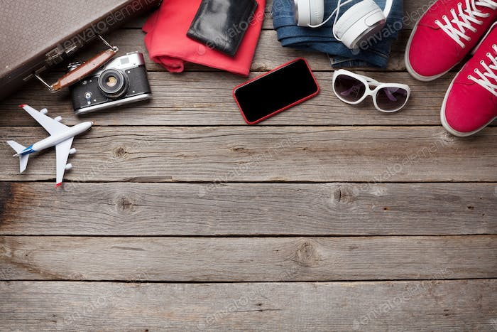 Suitcase, camera, clothes and travel accessories