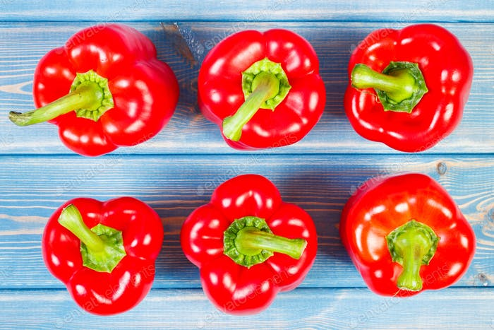 View from above on fresh red peppers on boards, healthy nutrition concept