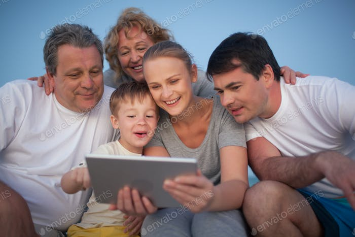 Happy family spending time with pad outdoor