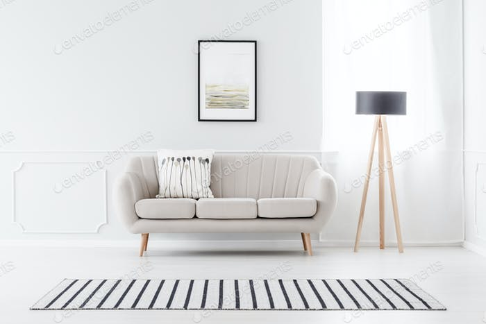 Couch against wall with molding