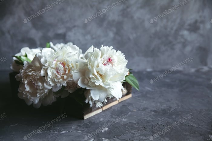 Peonies in wooden box