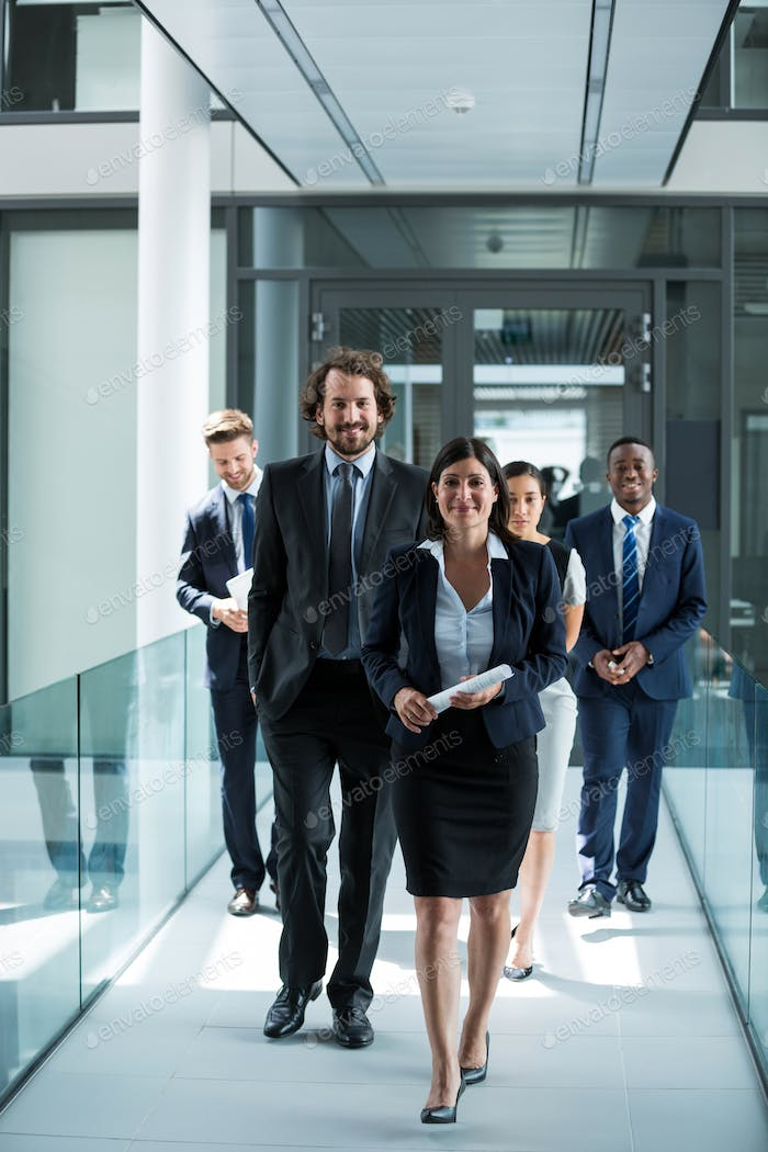 Businesswoman walking with colleagues