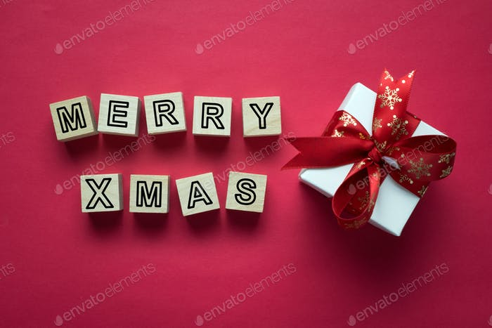 Merry Christmas lettering with holiday greeting gift