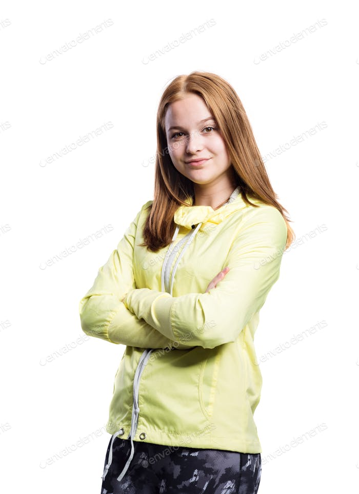 Girl in yellow running jacket and fitness leggings, isolated