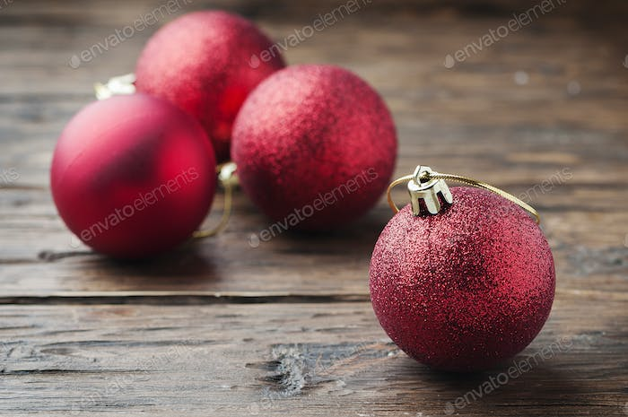 Christmas card with red balls on the wooden table