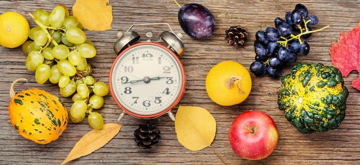 Beautiful autumn harvest and clock