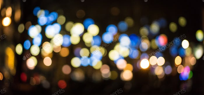 City night light blur bokeh, defocused background.