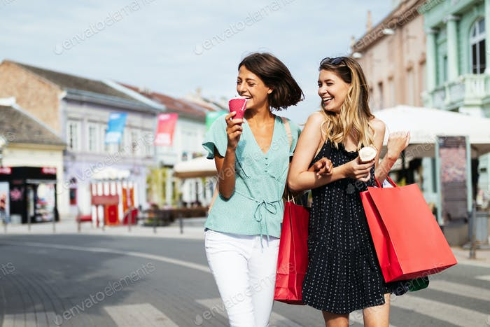 Group of happy women friends shopping in the city