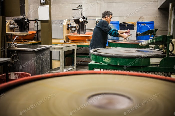 Man Working a Glass Blown Vase on Silica Sanding Disk