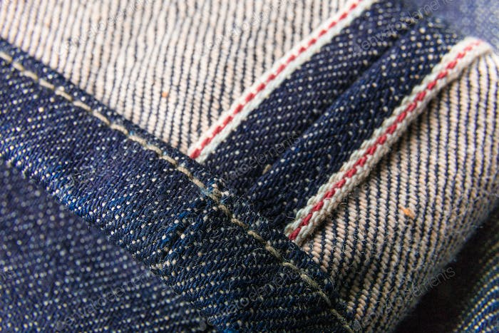 Close up of denim jeans red selvedge texture.
