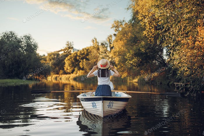 Love couple in boat on quiet lake, daydream