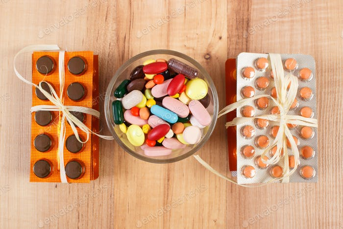 Heap of colorful medical pills and capsules, health care concept