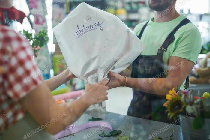 Delivery Man Giving Bouquet
