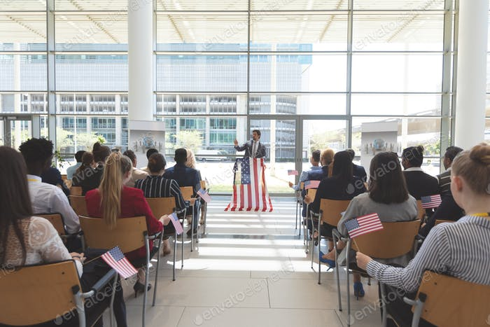 Front view of Caucasian businessman speaking at a business seminar in office building