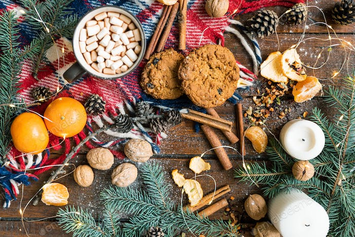 Christmas background with drink, cookies and other traditional food and symbols