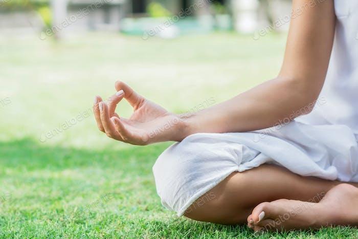 Yoga on a lawn