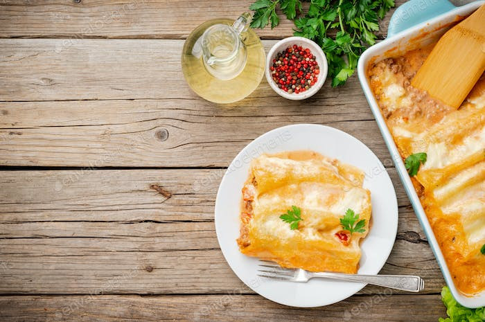 Cannelloni with filling of ground beef, tomatoes,