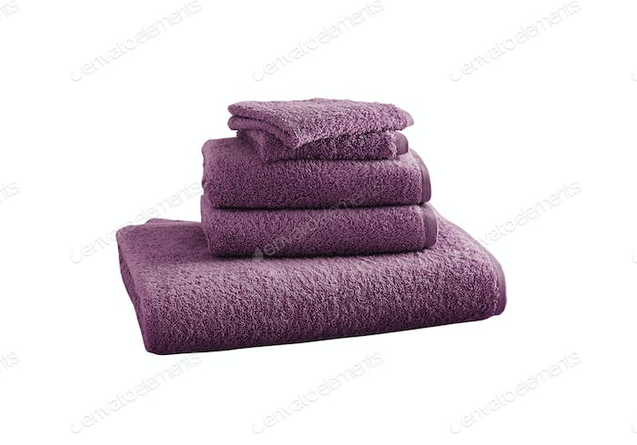 Stack of pink bath towels isolated on white background