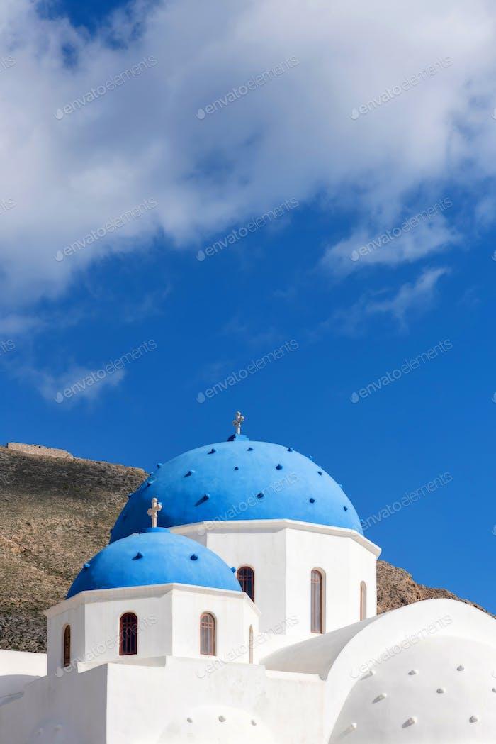 Blue domes of an Orthodox Church at sunrise in Santorini, Greece