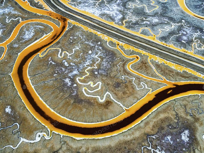 Salt flats, view from above. A winding road and meandering river