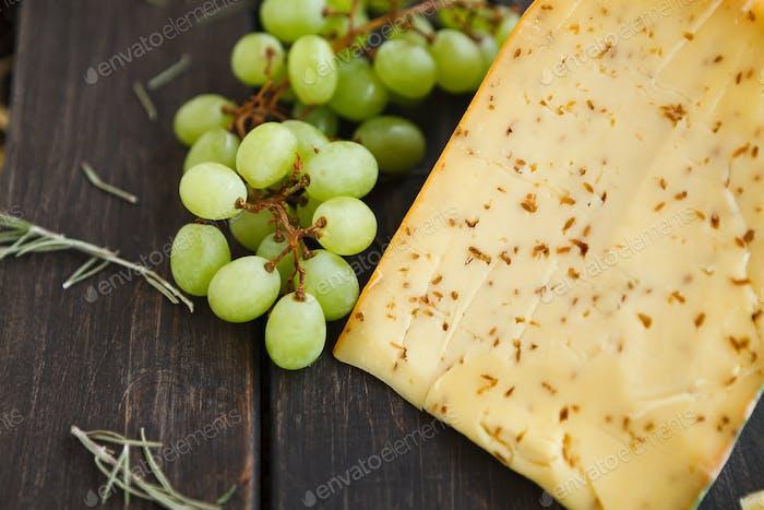 Gouda cheese with herbs closeup
