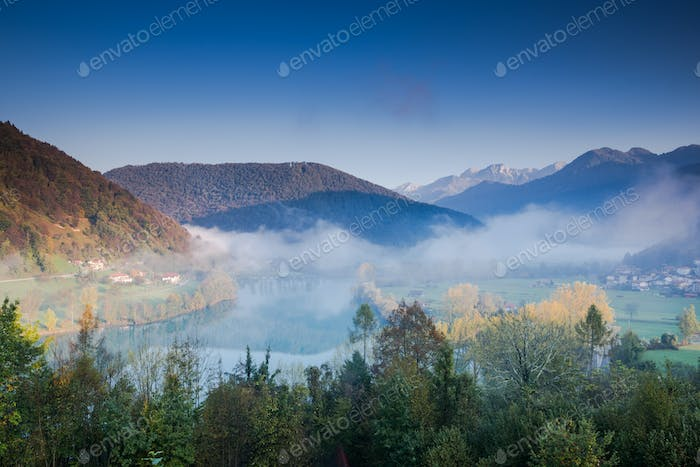 Mist over Most na Soci river with Julian Alps in Background, Slo
