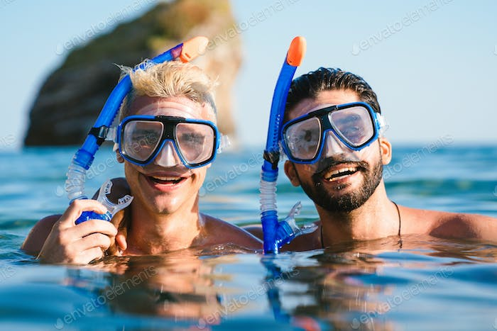 Happy friends enjoying summer vacation, travel during scuba diving