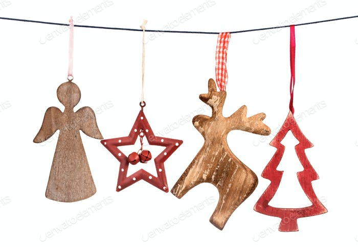 Old Christmas decorations hanging on string isolated