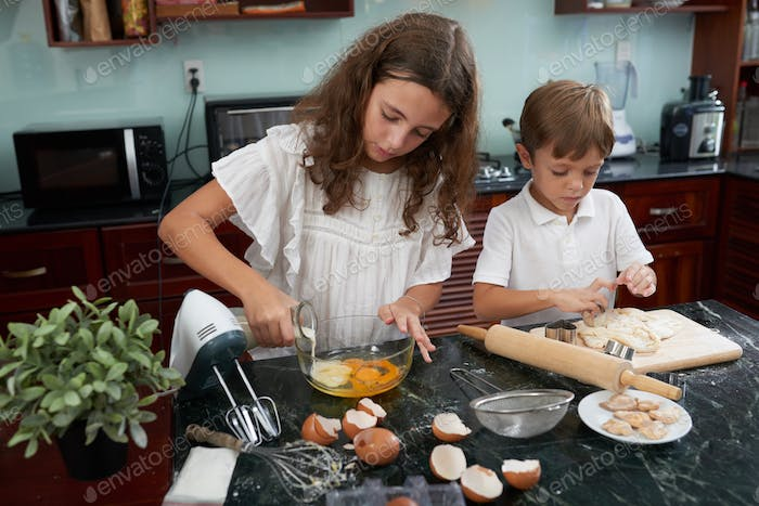 Brother and sister making cookies