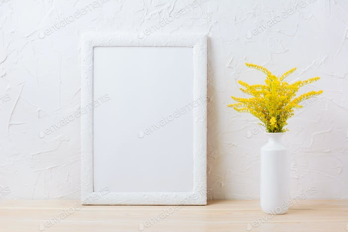 White frame mockup with ornamental yellow flowering grass in vas