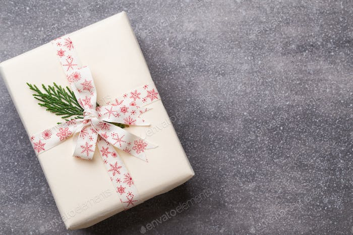 Christmas presents with ribbon on grey  background.