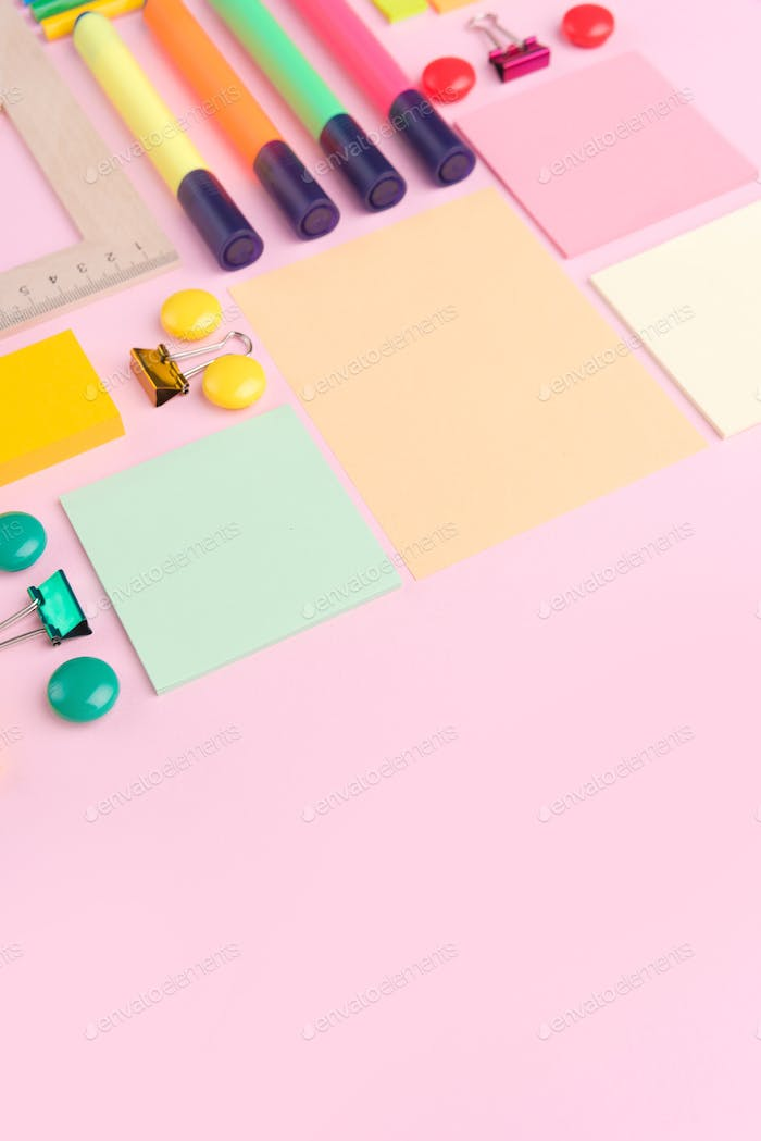 Office supplies on the pink background table