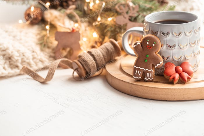 Christmas composition with gingerbread boy and beautiful cup with hot drink copy space.