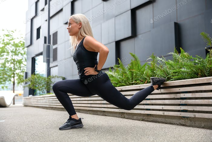 Woman Performing Lunges Workout for Thighs and Glute Outdoor in the City
