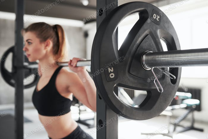 No pain, no gain. Photo of gorgeous blonde woman in the gym at her weekend time