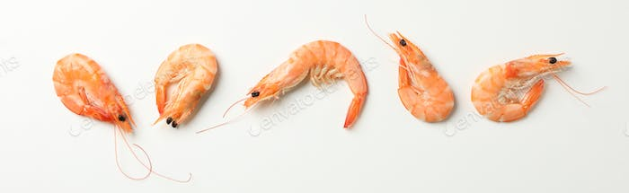 Flat lay with shrimps on white background, space for text
