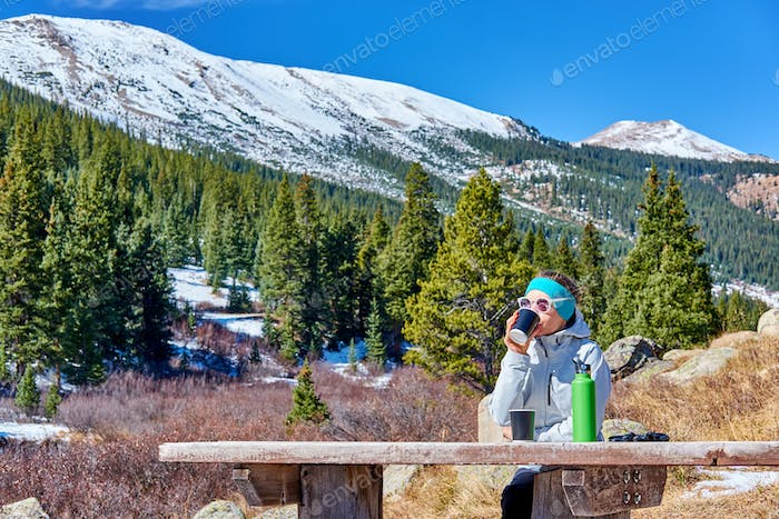 Hiker having rest on trail in Rocky Mountains