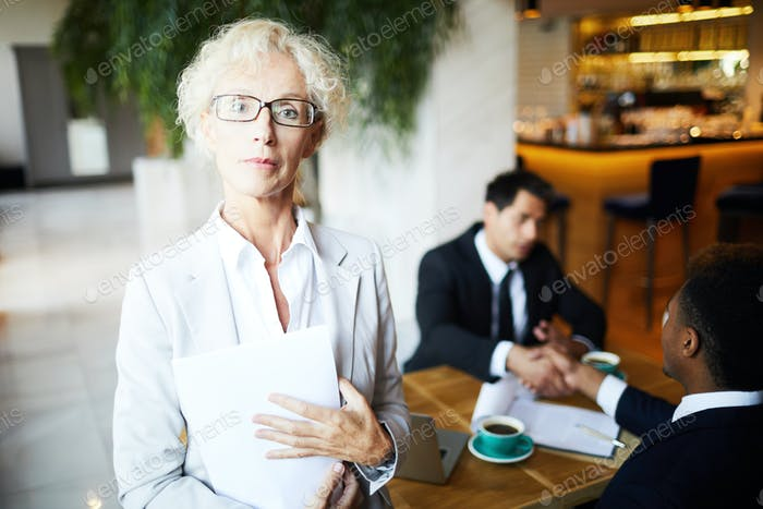 Businesswoman at meeting at restaurant