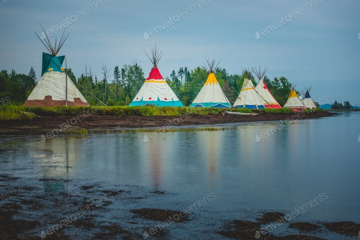 Traditional houses of native Americans installation