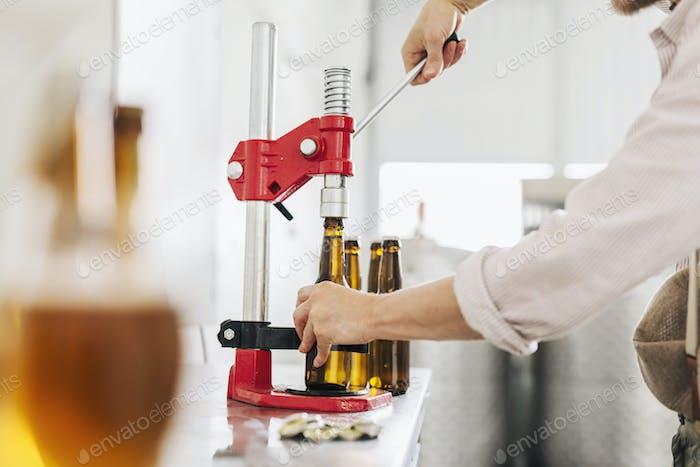 Brewery worker preparing beer bottles